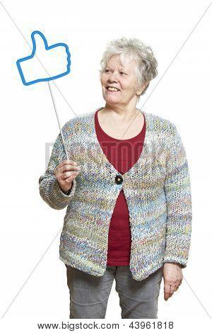 Senior Woman Holding A Social Media Sign Smiling