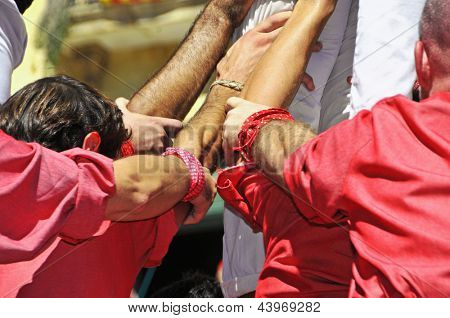 TARRAGONA, SPAIN - SEPTEMBER 16: Castells on September 16, 2012 in Tarragona, Spain. Every year, during Santa Tecla festival, those typical catalan human towers are performed in Plaza de la Font
