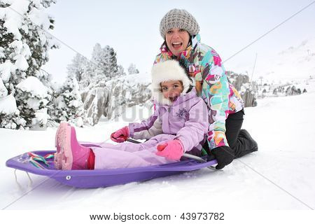 Mother and daughter sledging poster