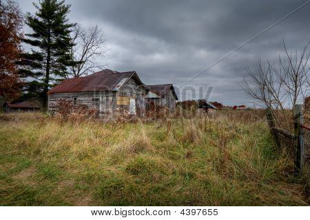 Abandoned Barn Under Storm Clouds