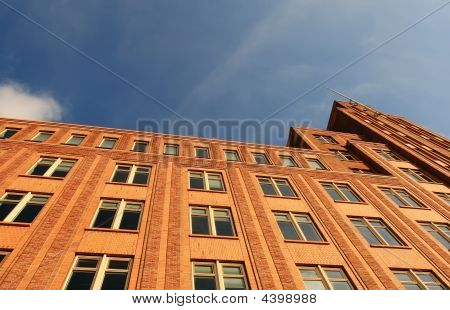 Tall, Modern Building With Blue Sky