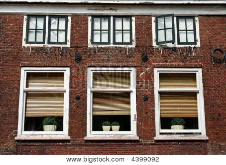 Windows Of An Old Red Brick House