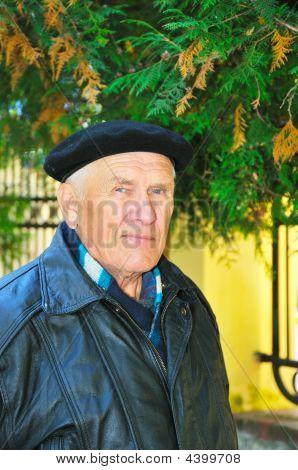 Elderly Man On Autumn Background