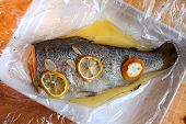 Rainbow trout baked with garlic and lemon in foil. Healthy food poster
