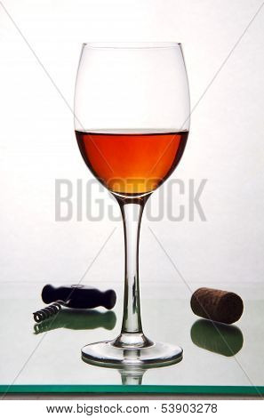 Glass Of Alcohol, Cork And A Corkscrew.