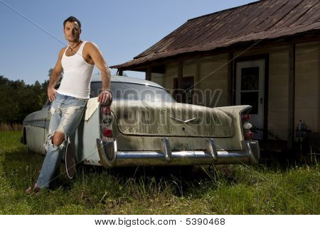 Young Male Model With Old Car