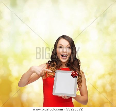 christmas, x-mas, electronics, gadget concept - smiling woman in red dress with blank screen tablet pc
