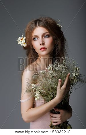 Sentimentality. Redhaired Affectionate Muse With Flowers In Dreams