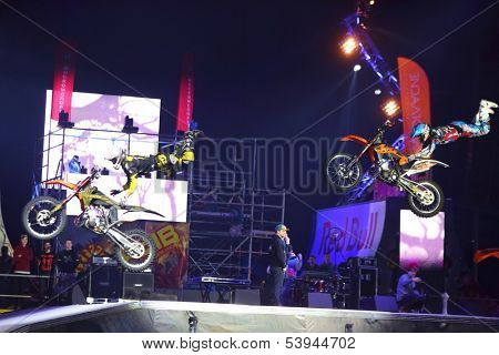 MOSCOW - MAR 02: Simultaneous jump motorcyclists on the festival extreme sports Breakthrough 2013 in the arena of the Sports Complex, on March 02, 2013 in Moscow, Russia.