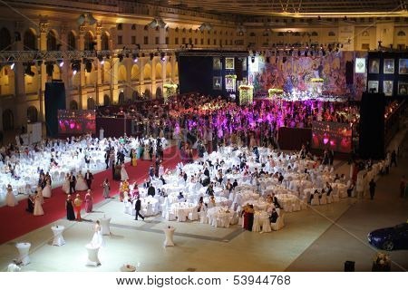 MOSCOW - MAY 25: Hall with tables and people in beautiful dress under purple lights at 11th Viennese Ball in Gostiny Dvor on May 25, 2013 in Moscow, Russia.