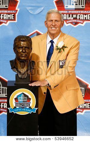 CANTON, OH-AUG 3: Former head coach Bill Parcells poses with his bust during the NFL Class of 2013 Enshrinement Ceremony at Fawcett Stadium on August 3, 2013 in Canton, Ohio.