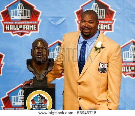 CANTON, OH-AUG 3: Former Dallas Cowboys offensive lineman Larry Allen poses with his bust during the NFL Class of 2013 Enshrinement Ceremony at Fawcett Stadium on August 3, 2013 in Canton, Ohio.