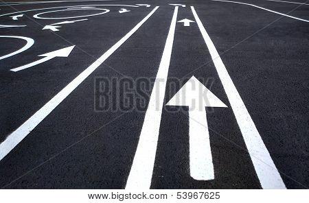 Arrow traffic on the asphalt road