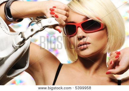 Trendy Woman With  Red Sunglasses Holding White Handbag