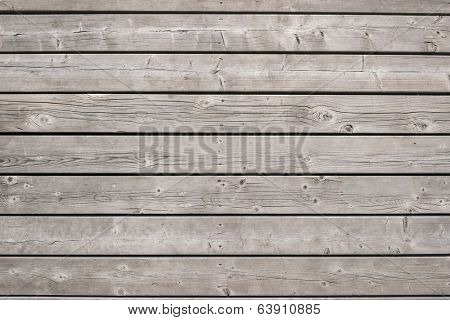Background of old wooden weathered unpainted deck planks