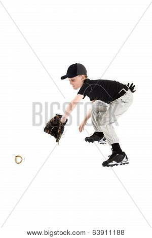 Young Caucasian Boy Catching A Baseball With Mitt Backhanded
