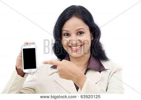 Young business woman showing with black display of mobile phone