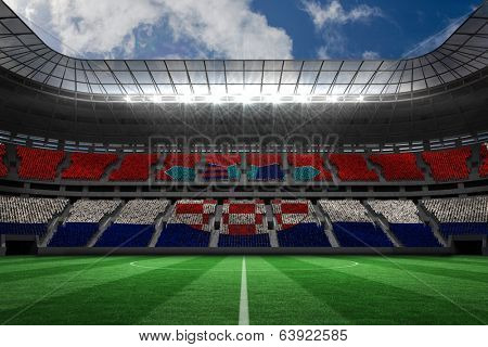 Digitally generated croatia national flag against large football stadium poster