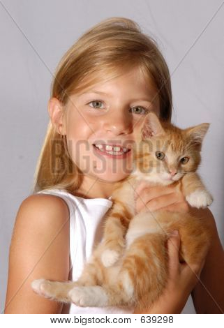 Young girl with her kitten in studio. Girl is wearing white shirt and kitten is a gold tabby poster