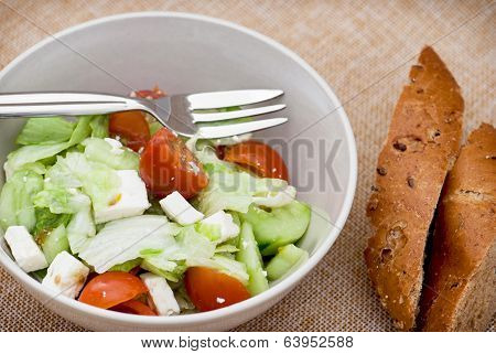 Fetta Salad Portion And Slices Of Whole Wheat Bread