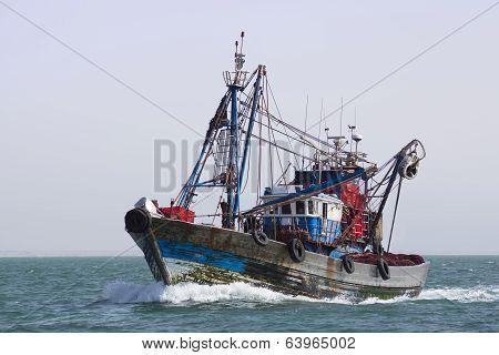 A Fishing Boat Is At Sea Fishing.