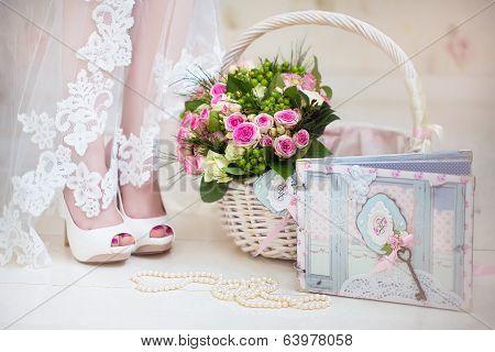 The bride on her wedding day. Morning bride. Wedding accessories. Wedding bouquet into basket. Strin