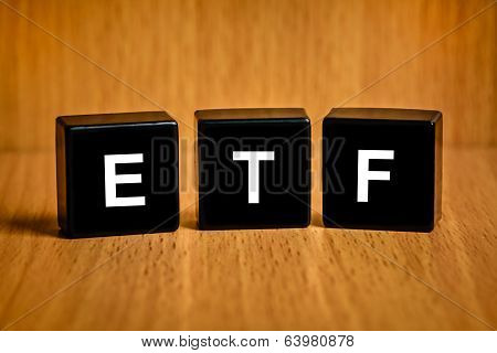 Etf Or Exchange Traded Fund Word On Black Block