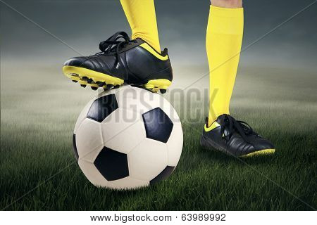 Feet Player With A Soccer Ball