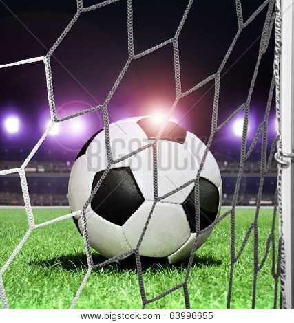 closeup soccer ball on green grass of night stadium