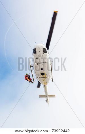 Rescuer Descending From Helicopter