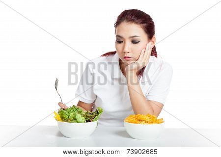 Asian Girl Fed Up With Crisps And Salad