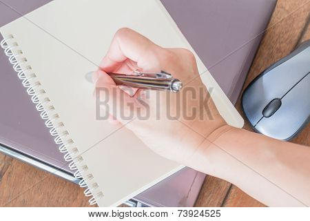Hand Writing On Note Paper At Workplace