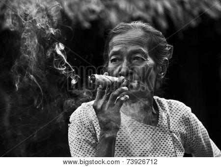 Asiatic Woman Smoking A Cigar