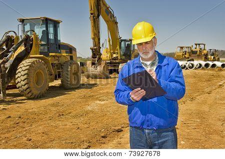 Supervisor Taking Notes On Site