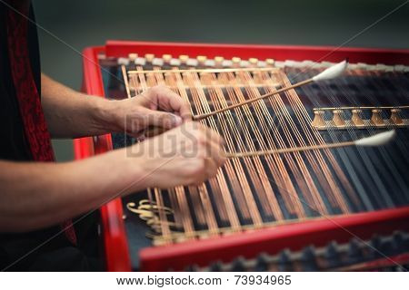 Playing the dulcimer folk musical instrument from Europe