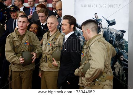 NEW YORK-OCT 15: Actor Brad Pitt poses with soldiers at the world premiere of