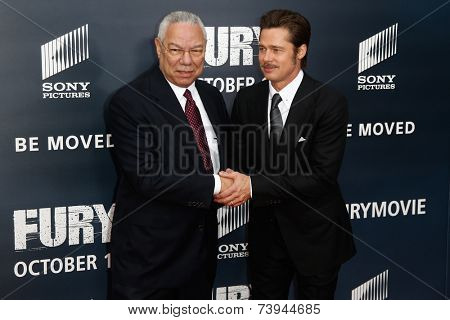 NEW YORK-OCT 15: General Colin Powell (L) shakes hands with actor Brad Pitt at the world premiere of