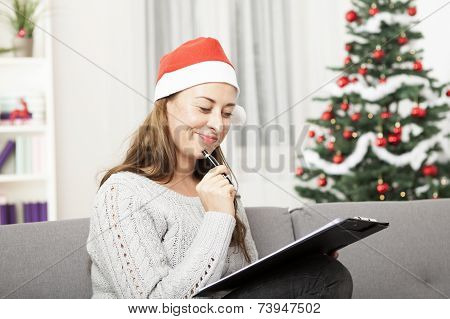 Young Woman Think About Christmas Wih List