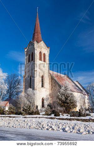 Church in rural place winter shot in Estonia poster