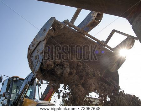 The machine, wheel loader during backfilling around the foundation of the building on the site poster