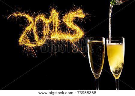 Bottle Filling Champagne Glasses For Celebrating New Years Eve 2015