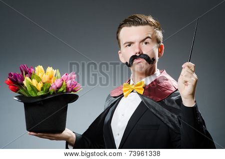 Funny magician with wand and hat