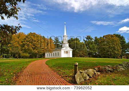 The Martha Mary Chapel in Sudbury, MA on a sunny day in Fall. It is a non-denominational white clapboard chapel. poster