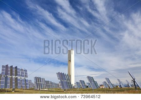 Solar tower surrounded by mirror panels harnessing the sun's rays to provide alternative renewable green energy. Situated in Adalucia, Spain, just outside Seville.