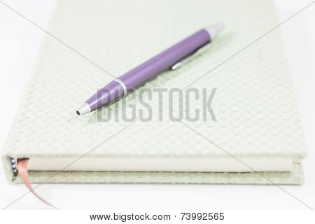 Closeup Notebook And Pen On White Background