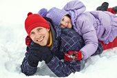portrait of father and daughter. Family walking outdoors in winter poster