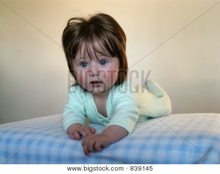 Cute baby girl on the blanked
