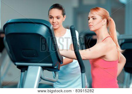Cute teenage girl and her mom at sports club