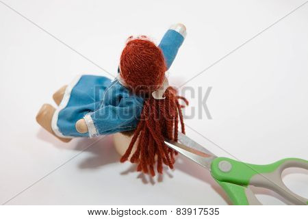 Closeup On Scene Of A Doll Before A Haircut