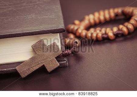 Christian cross necklace on Holy Bible book Jesus religion concept as good friday or easter festival poster